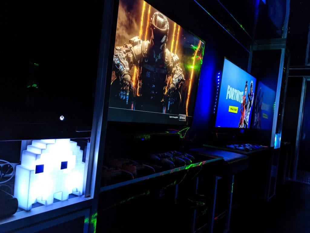 call of duty and fortnite games on display inside the gaming truck